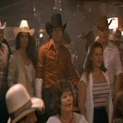 Me walking in front of John Travolta In The Movie Urban Cowboy