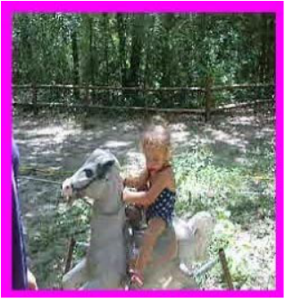 little girl on spring horse