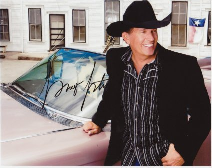 George Strait wearing a black sport coat