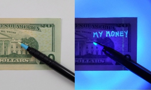 dollar bill with invisible ink mark