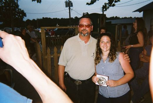cowgirl winning a belt buckle
