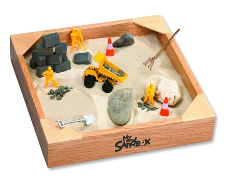 sandbox with construction toys