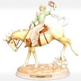 cowgirl on horse figurine