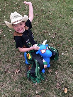kid on bull riding toy