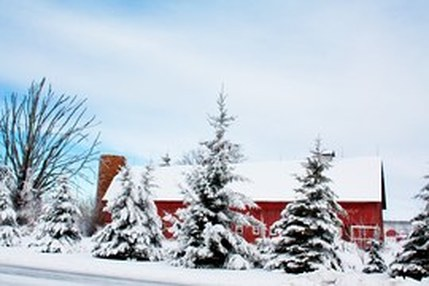 red barn in winter snow